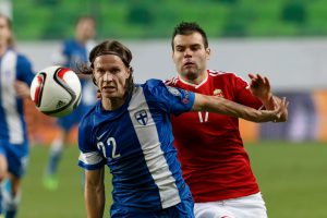 Budapest, Hungary - November 14, 2014: Duel between Hunagrian Nemanja Nikolic (r) and Finnish Jarkko Hurme during Hungary vs. Finland football match in Groupama Arena on November 14, 2014 in Budapest, Hungary.